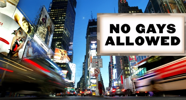 Cars drive through Times Square. The logo of the 'No Gays Allowed' ad campaign(Mario Tama/Getty)