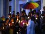 Transgender activists and their supporters take part in a candle light vigil. (Getty)