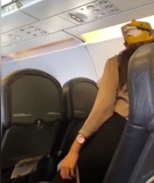 Woman leans over and insults fellow plane passenger with homophobic slurs