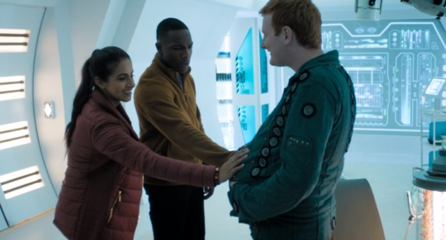 Yoss (Jack Shalloo) with Yaz (Mandip Gill) and Ryan (Tosin Cole).