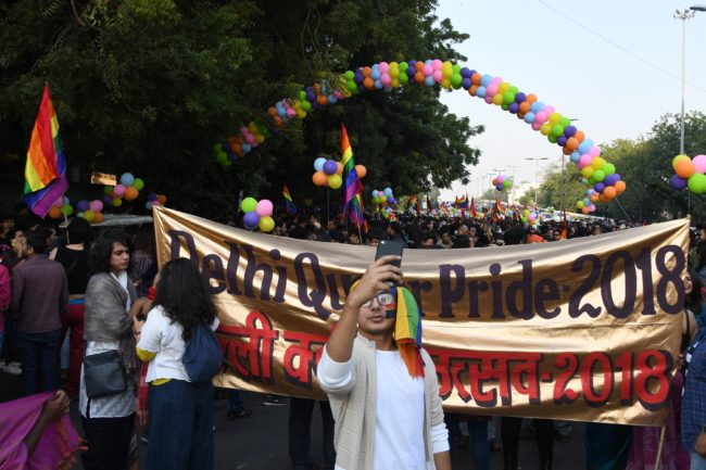A participant takes a picture on his smartphone as Indian LGBT people celebrate in Delhi