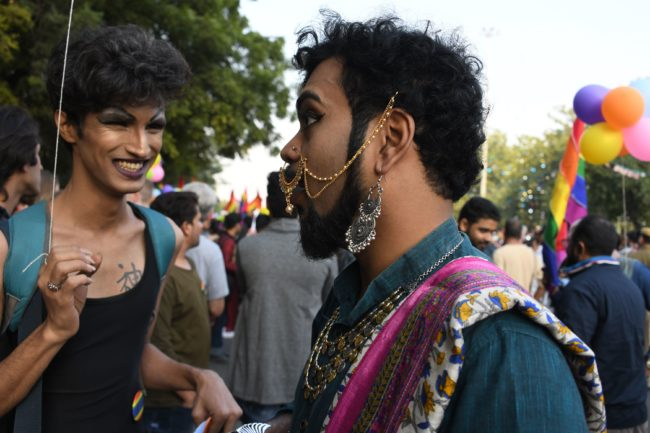 Attendees celebrate the first Pride parade after the landmark ruling by country's top court legalising gay sex
