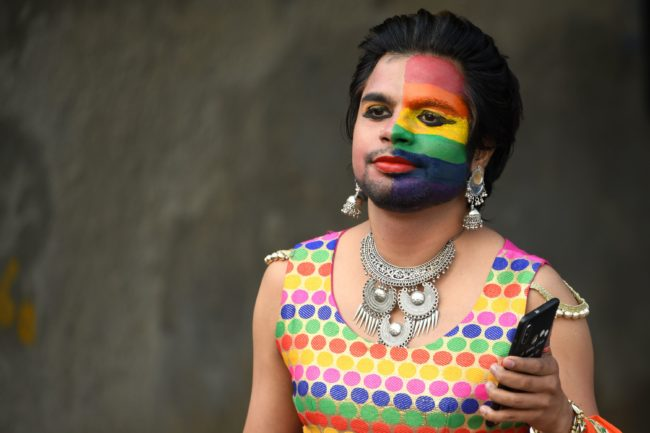 Gay India pride: One of the thousands of people wearing rainbow-coloured outfits who rallied in the Indian capital territory on November 25
