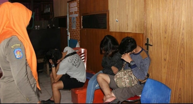 Police have arrested 10 women on suspicion of them being lesbians. (HUMAS SATPOL PP Padang/Facebook)