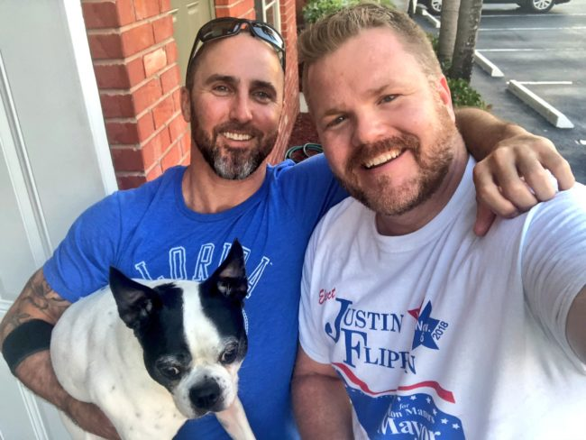 Openly gay commissioner Justin Flippen campaigned door to door to be  elected mayor.