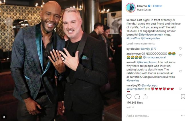 Karamo Brown and Ian Jordan pose with their engagement rings on Instagram