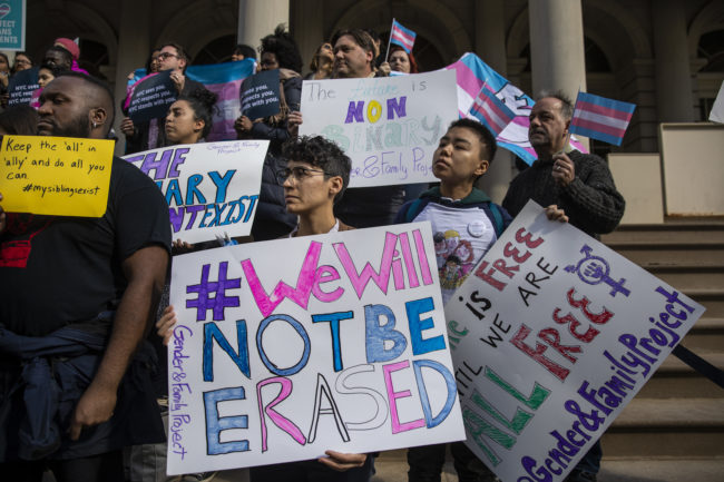 LGBT activists rally in support of transgender people on the steps of New York City Hall