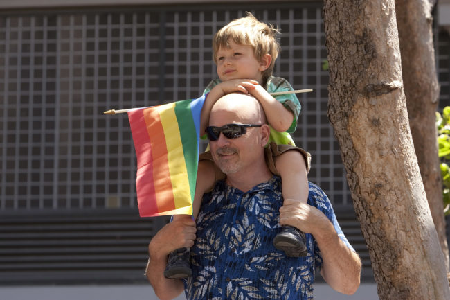 A man holds his son at the Pride parade in San Francisco, California.