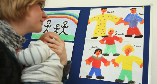 File photo. A woman attends the opening of Germany's first gay parent counseling center on March 15, 2013 in Berlin, Germany. (Sean Gallup/Getty)