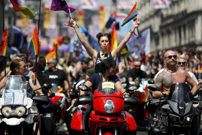 Woman on a vehicle celebrates the annual Pride Parade in London