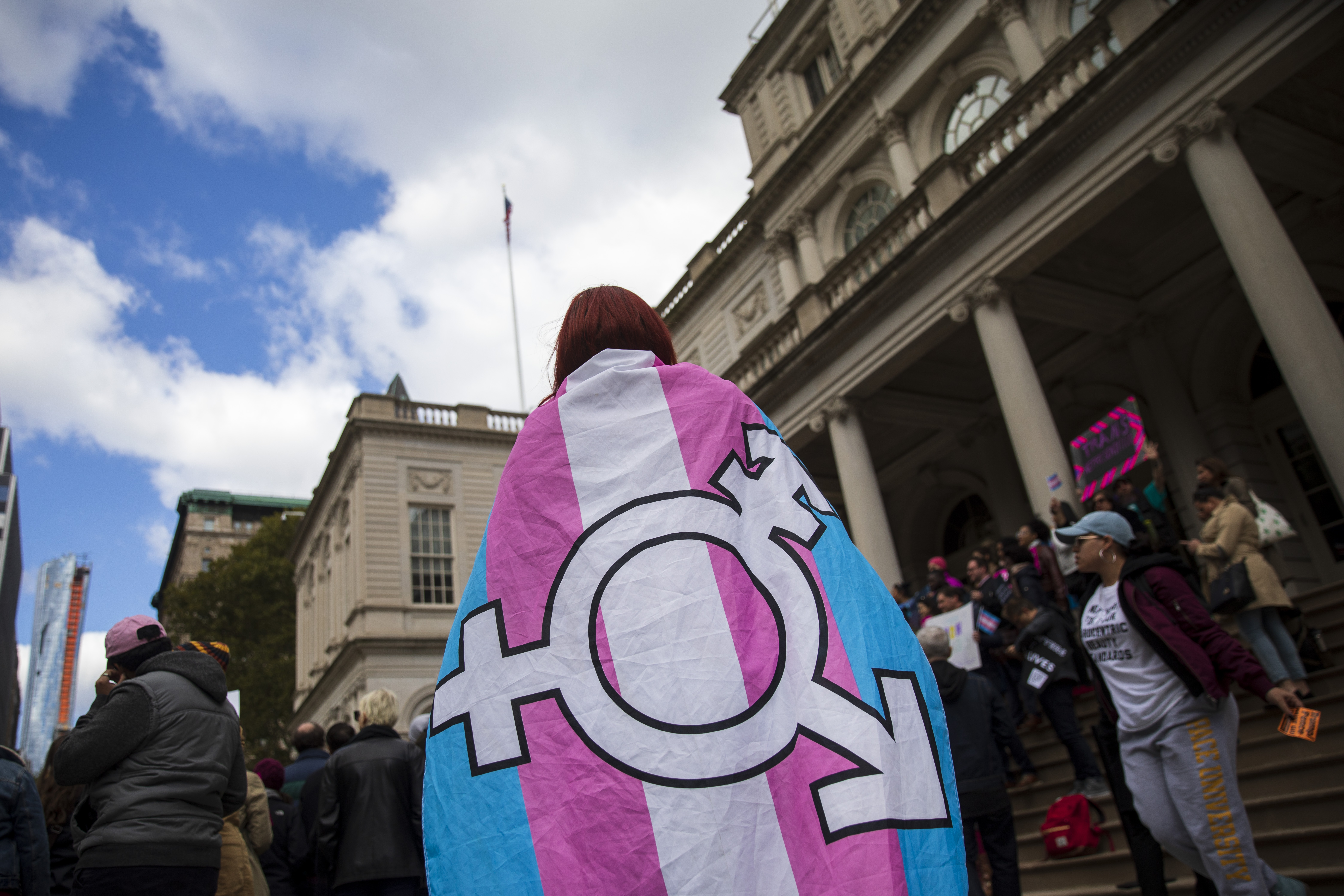 A person draped in a transgender flag. (Drew Angerer/Getty)