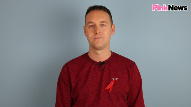 HIV activist Tom Hayes wears a World AIDs Day ribbon