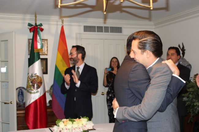 Gay Mexican couple embrace after being declared married.