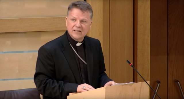 Bishop John Keenan, head of the Diocese of Paisley in Scotland, addresses the Scottish Parliament in 2016.