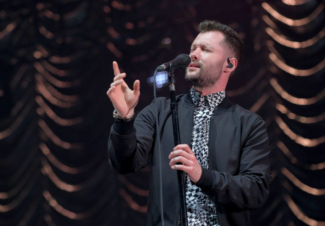 Calum Scott performs on stage
