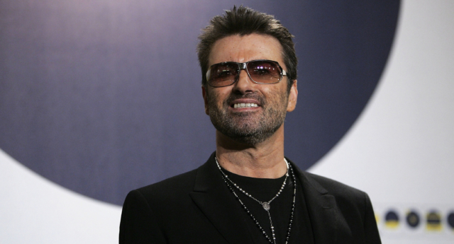 """George Michael poses at the """"George Michael: A Different Story"""" Photocall during the 55th annual Berlinale International Film Festival on February 16, 2005 in Berlin, Germany. (Sean Gallup/Getty Images)"""