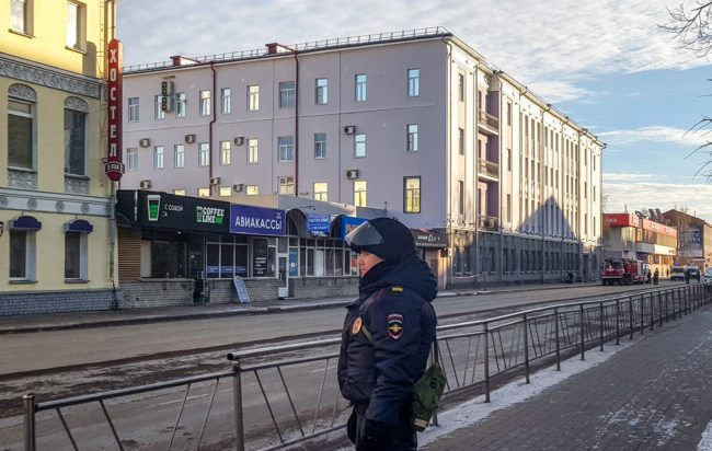 Russian police patrol a street near a building housing the FSB security service in Arkhangelsk on October 31, 2018.