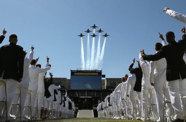 The Blue Angels fly over U.S. Naval Academy graduation ceremonies, although cadets who are diagnosed as HIV-positive will not have a chance to commission under longstanding military HIV ban.