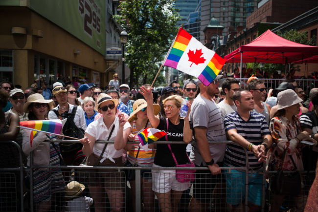 Spectators attend the annual Pride Festival parade in Toronto, Canada, where the new $1 coin will be released in 2019.