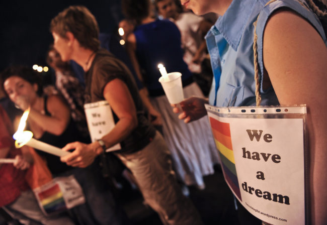 "Italian gay rights supporters take part in a ceremony to protest against increasing instances of homophobia, one of the issue the survey condemned for ""promoting sexual fluidity"" was meant to address."