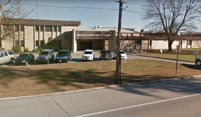 Photo of Leo Junior/Senior High School outside cars. The school is facing a lawsuit from the Gay-Straight Alliance