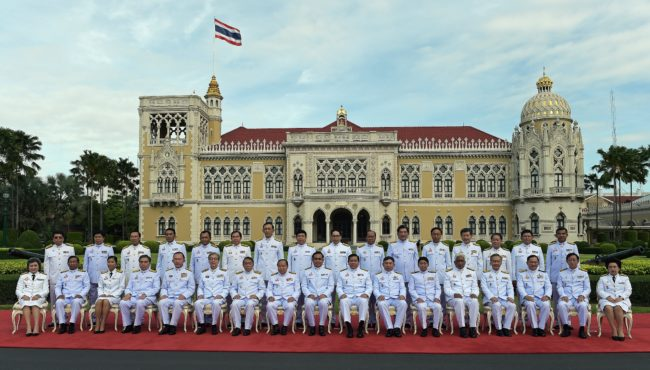 Thailand's junta chief and prime minister Prayut Chan-O-Cha sits with members of his cabinet at Government House in Bangkok on August 25, 2015.