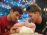 Dustin Lance Black and husband Tom Daley with their son Robbie in a Christmas advert for Pampers. (Instagram/TomDaley)
