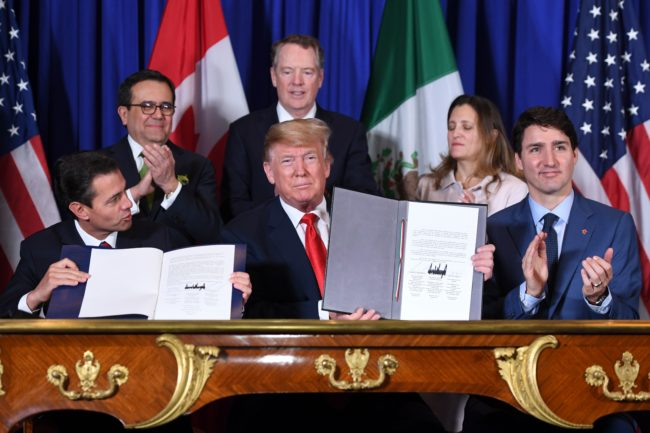 Mexico's President Enrique Pena Nieto, US President Donald Trump, and Canadian Prime Minister Justin Trudeau, sign a new USMCA free trade agreement in Buenos Aires, on November 30, 2018.