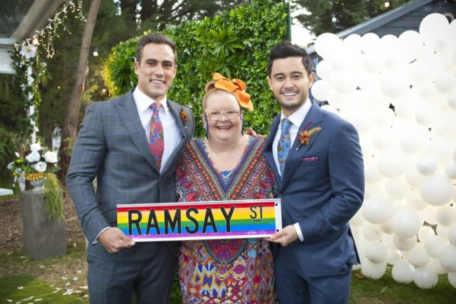Neighbours characters Aaron Brennan and David Tanaka pose with Magda Szubanski