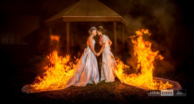 Two brides set their wedding dresses on fire at their marriage ceremony