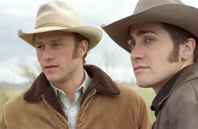 The stars of 2005 film Brokeback Mountain look into the distance