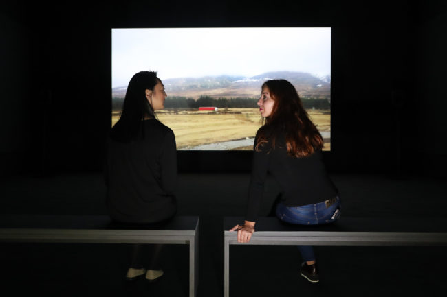 People watching Bridgit, a film by Charlotte Prodger, at Tate Britain in London