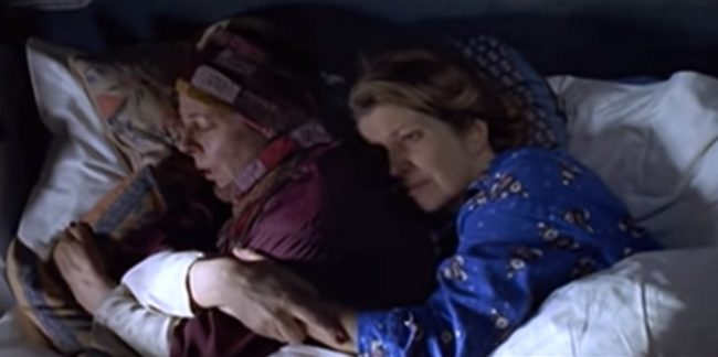Frances de la Tour and Anne Reid embrace in a Love Actually scene
