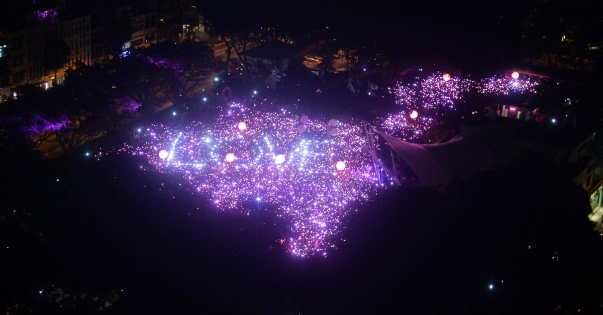 "Lights that read ""love"" are seen as thousands gather for at the annual ""Pink Dot"" event in a public show of support for the LGBT community at Hong Lim Park in Singapore on June 13, 2015. (Mohd Fyrol/AFP/Getty)"