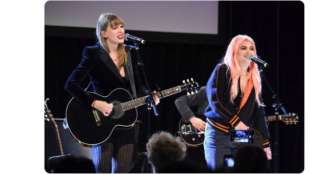 "Taylor Swift joined Hayley Kiyoko on stage for a ""Delicate"" duet. (Screenshot/Twitter)"