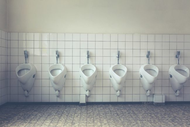 A row of urinals in a bathroom
