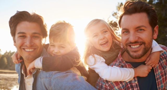 A gay male couple with children. (Adobe stock photo)