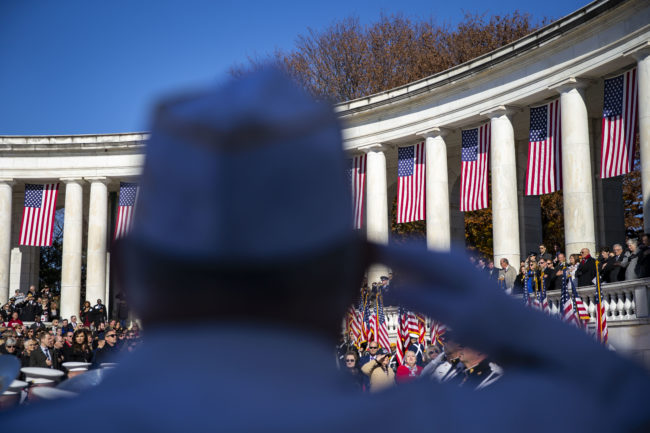 A veteran salutes as the Honor Guard arrives during a Veterans Day ceremony at Arlington National Cemetery, on November 11, 2018 in Arlington, Virginia.