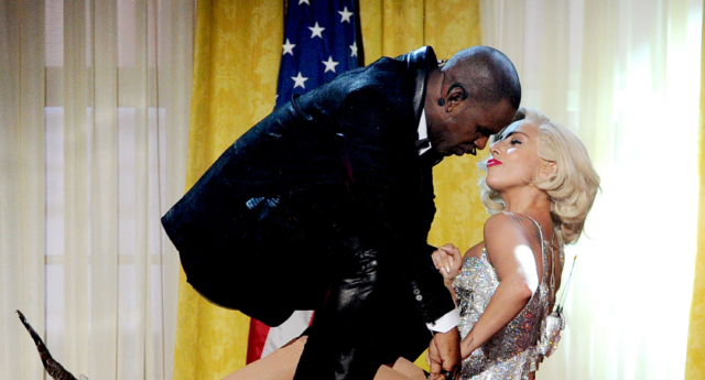 "Singers R. Kelly (L) and Lady Gaga perform  ""Do What u Want (With My Body)"" onstage during the 2013 American Music Awards.  (Kevin Winter/Getty)"