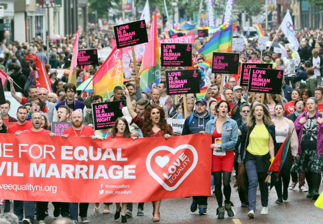 Gay rights campaigners take part in a march through Belfast on July 1, 2017 to protest against the ban on same-sex marriage.