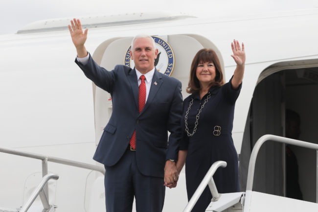 US Vice-President Mike Pence and his wife Karen Pence wave upon landing at a military air base in Brasilia June 26, 2018.