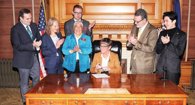 Governor of Kansas Laura Kelly signs an executive order protecting LGBT+ state employees from discrimination (Laura Kelly)
