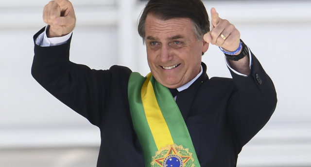 Brazil's new president Jair Bolsonaro gestures after receiveing the presidential sash from outgoing Brazilian president Michel Temer at Planalto Palace in Brasilia on January 1, 2019.  (EVARISTO SA/AFP/Getty)