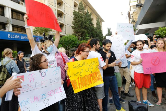 Activists from of the Lebanese LGBT community take part in a protest outside the Hbeish police station in Beirut on May 15, 2016, calling for the abolition of article 534 of the Lebanese Penal code