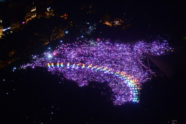 Supporters form a rainbow among lights at the annual Pink Dot event in a public show of support for the LGBT community at Hong Lim Park in Singapore on July 1, 2017.