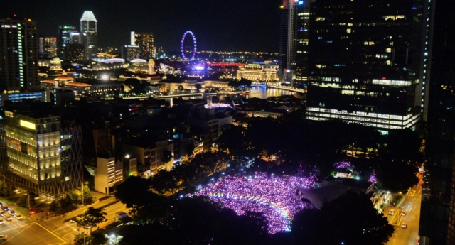 Supporters form a rainbow among lights at the annual Pink Dot event in a public show of support for the LGBT community at Hong Lim Park in Singapore on July 1, 2017. (ROSLAN RAHMAN/AFP/Getty)