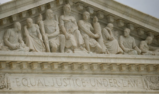 American Bar Association: A carving's on the front of the U.S. Supreme Court building reads 'Equal Justice Under Law'