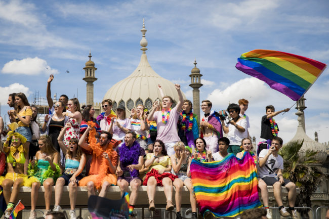 Crowds watch the parade during Brighton Pride 2018 on August 4, 2018 in Brighton, England