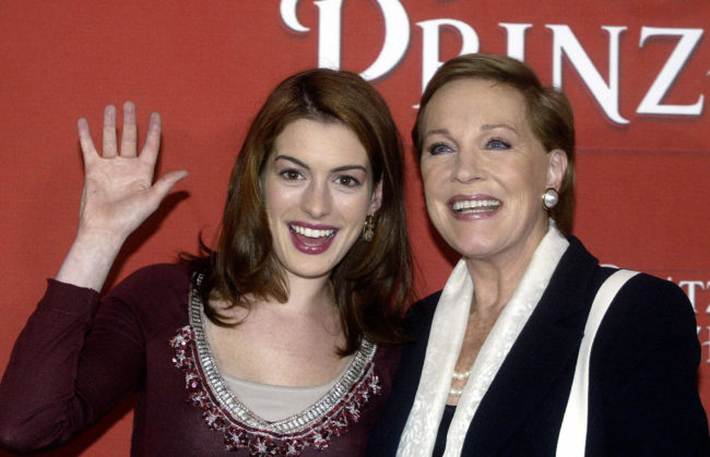 Julie Andrews and Anne Hathaway pose during a photocall in Munich, on 22 September 2004, for Princess Diaries 2: The Royal Engagement