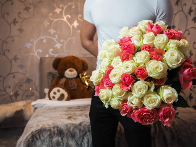 Valentine's Day gifts: Teddy bear and flowers